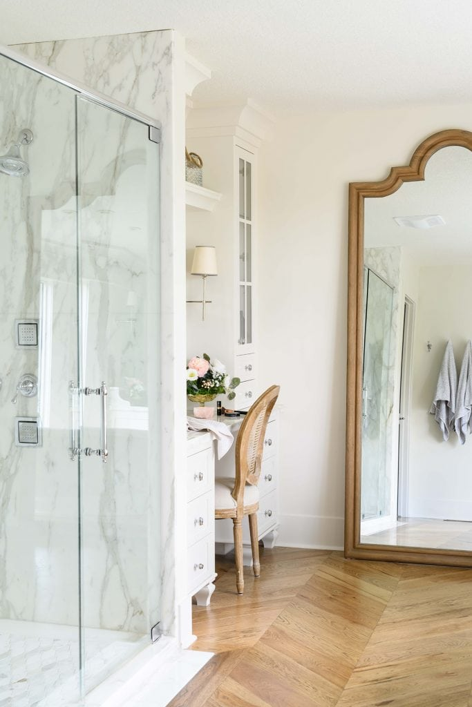 white marble shower in gorgeous master bathroom