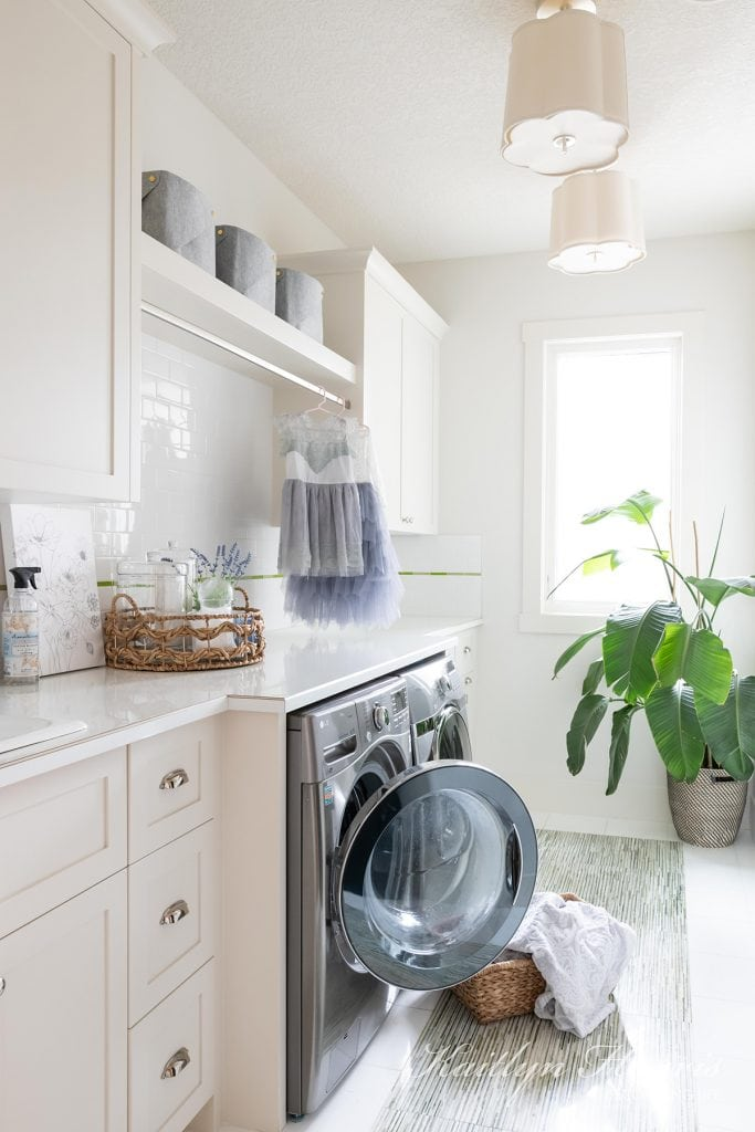 laundry room with marble countertops and pretty pendant lighting