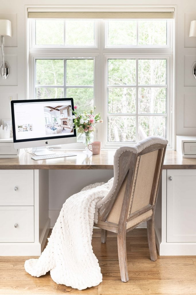 pretty and feminine white office with French chair
