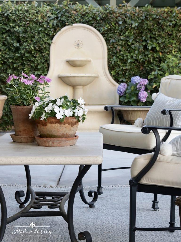 fountain and flowering pots on gorgeous European style patio summer decor ideas
