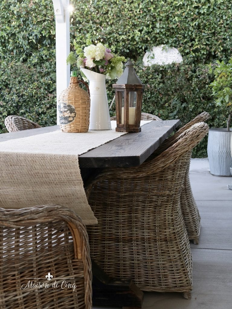 farmhouse table with wicker chairs patio furniture summer decorating ideas