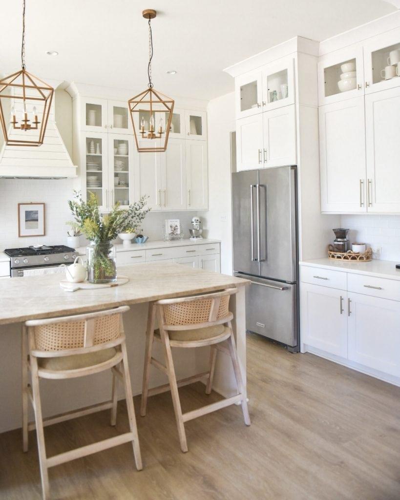 modern coastal farmhouse white kitchen glass cabinets and pendants