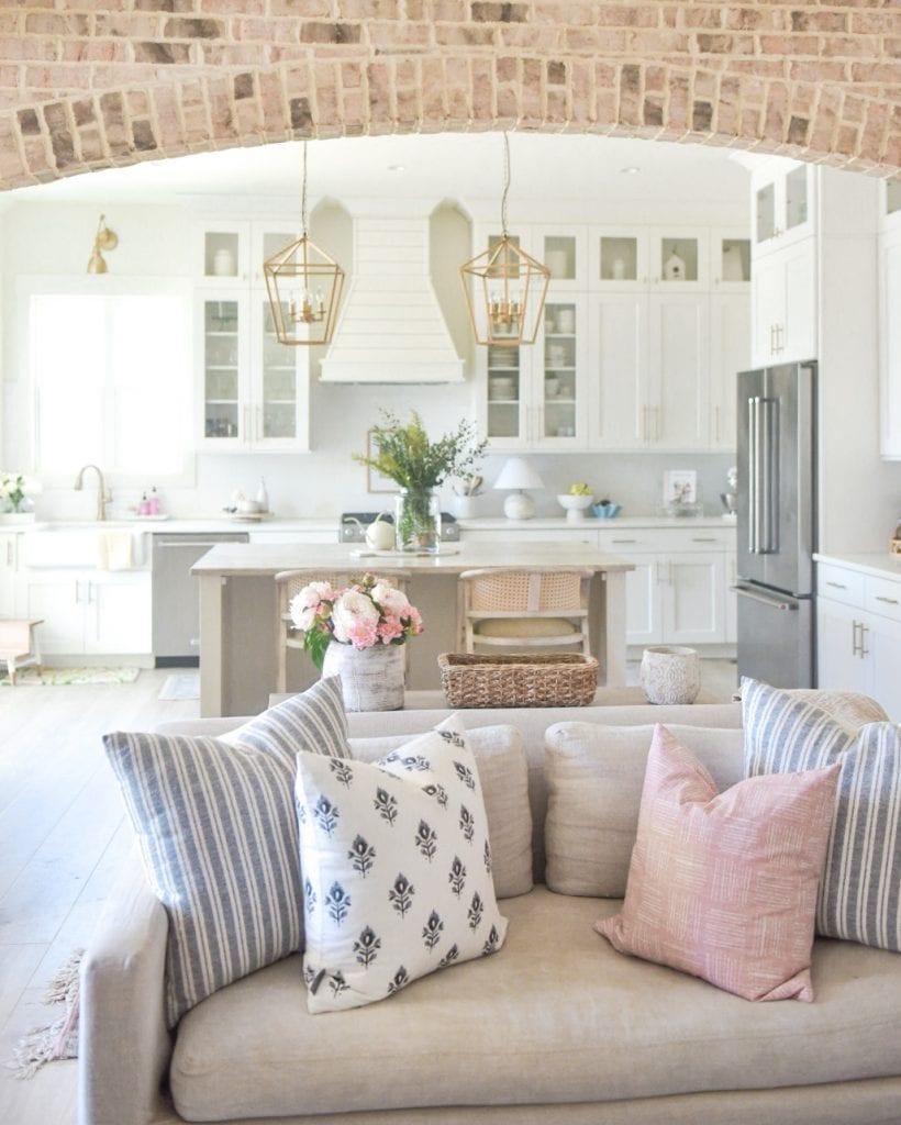 brick archway in open concept modern farmhouse kitchen