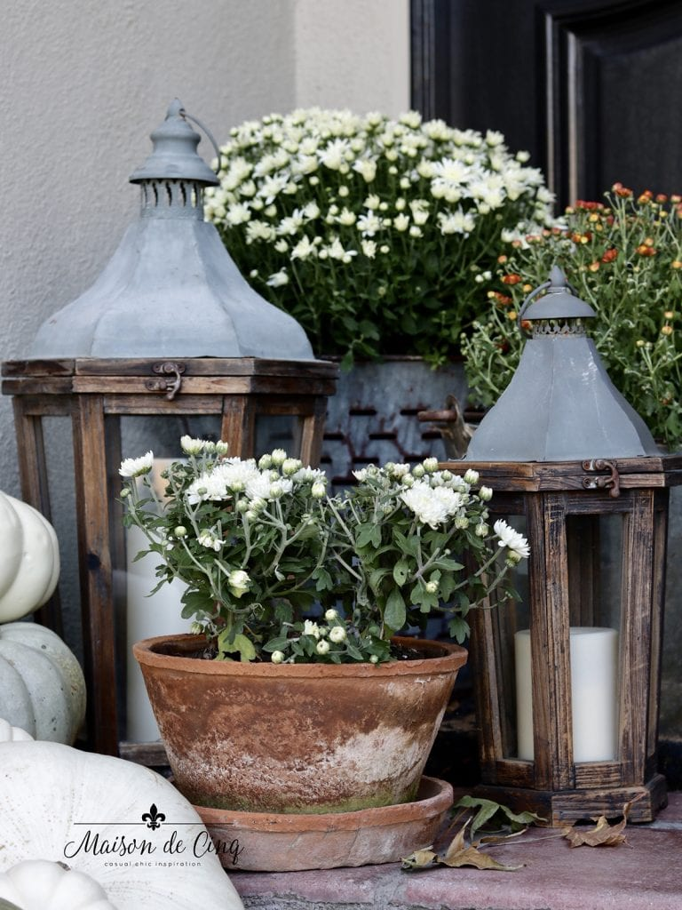 wood and metal lanterns with mums fall outdoor decorating