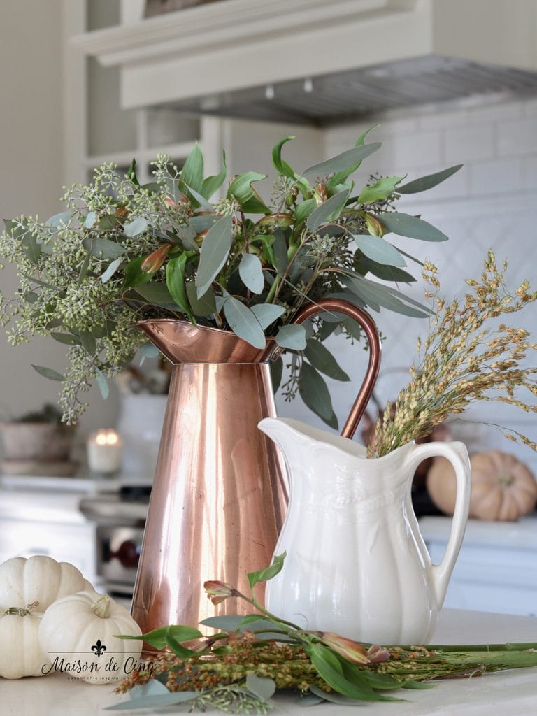 gorgeous fall decor with copper pitcher eucalyptus and white pumpkins