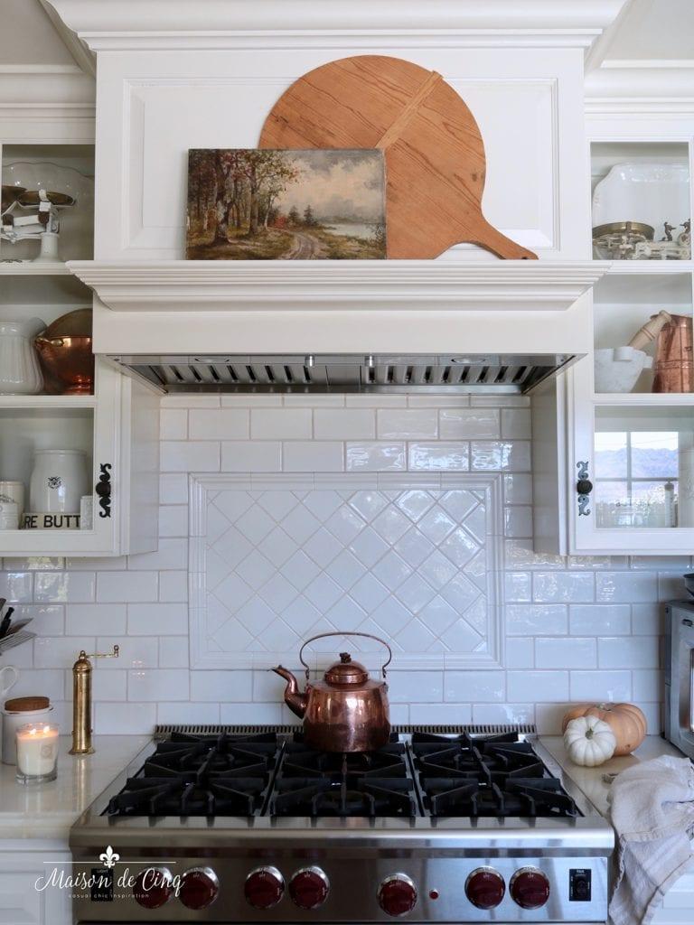 kitchen mantel over range with artwork and bread board fall decor