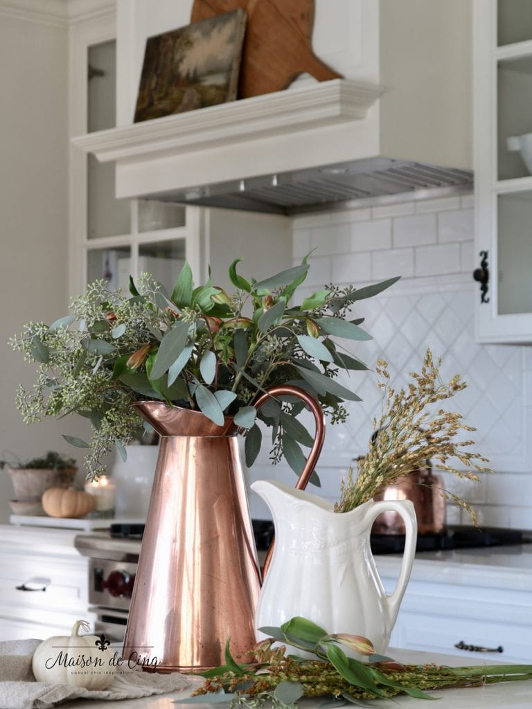 simple fall kitchen decorating ideas copper pitcher with eucalyptus pumpkins on counter