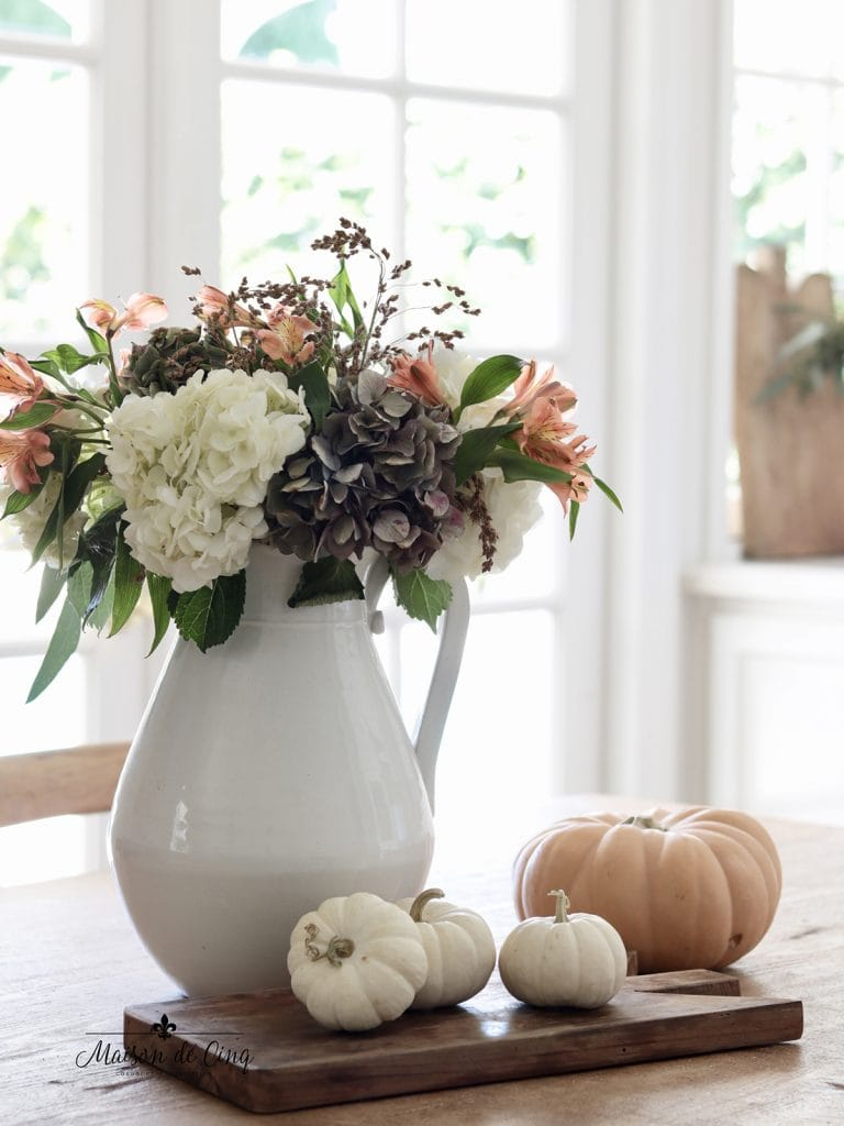 fall flowers with pumpkins on board fall decorating vignette
