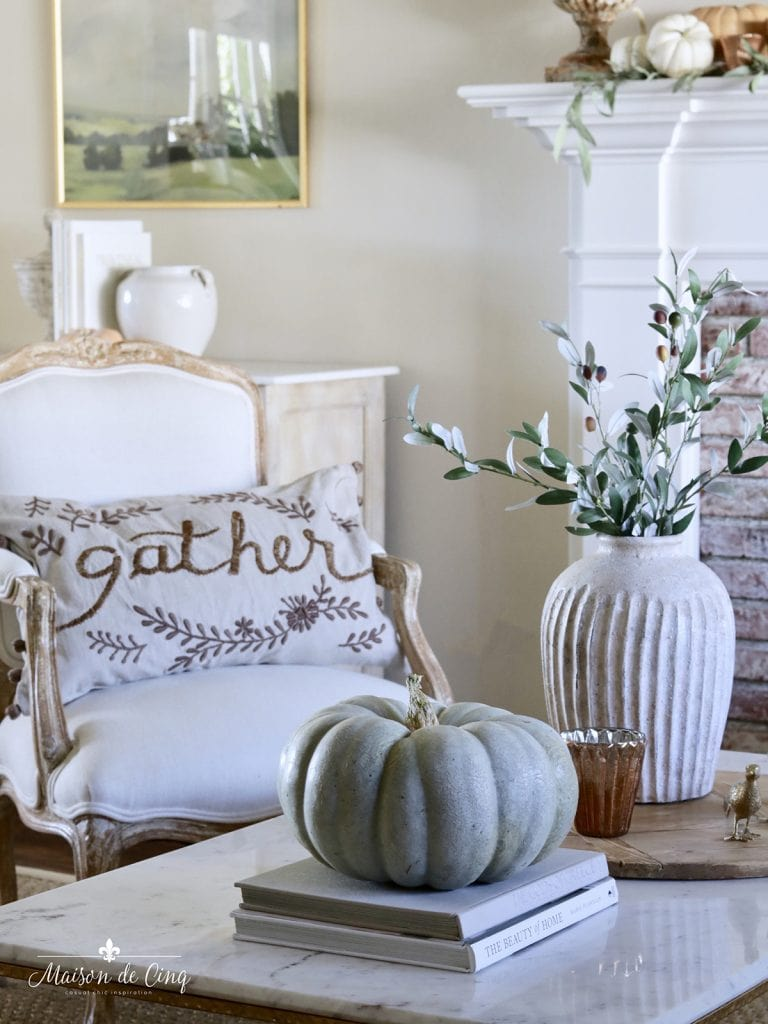 Jarrahdale pumpkin with rustic vase and branches neutral fall decorating ideas