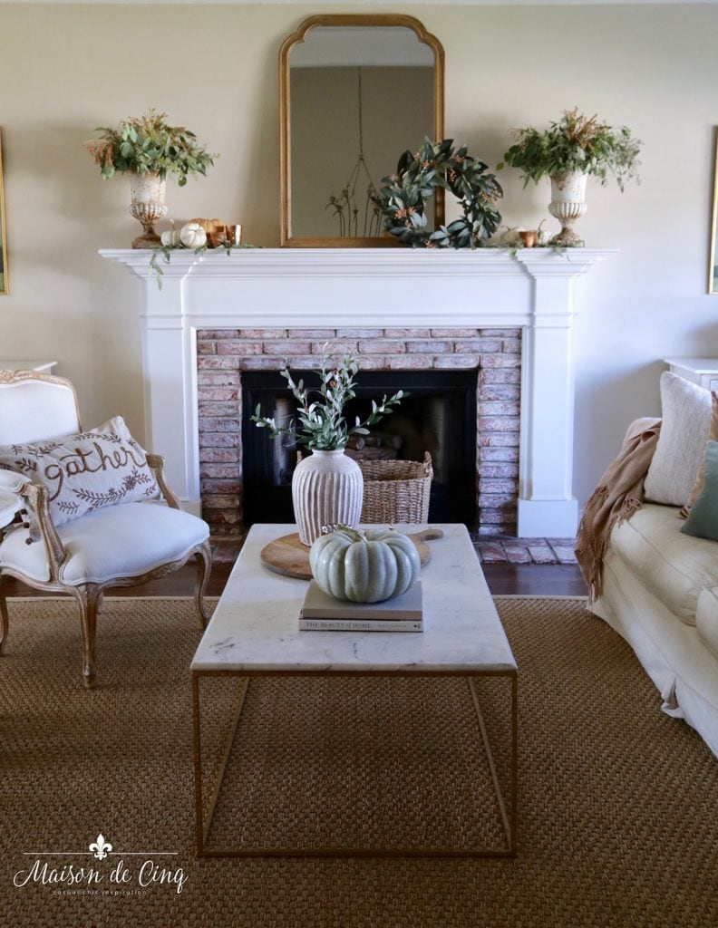 French farmhouse living room decorated in subtle fall colors mantel decorating ideas
