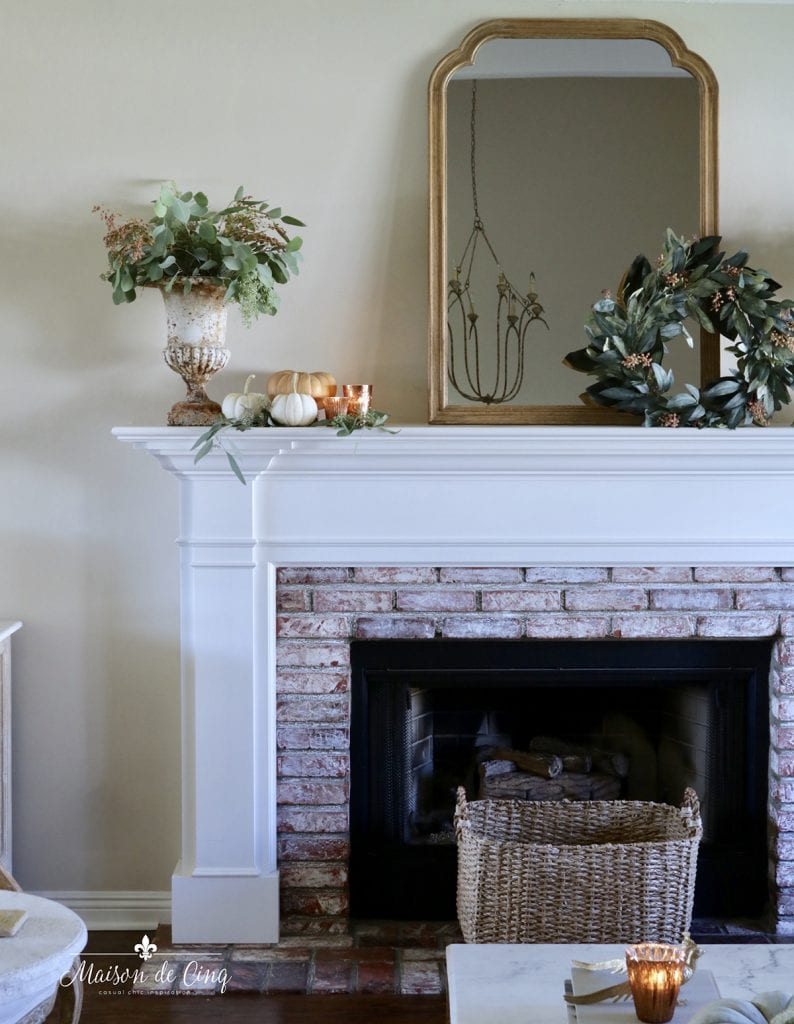 Fall mantel decor ideas French country mirror with beautiful urn wreath and pumpkins