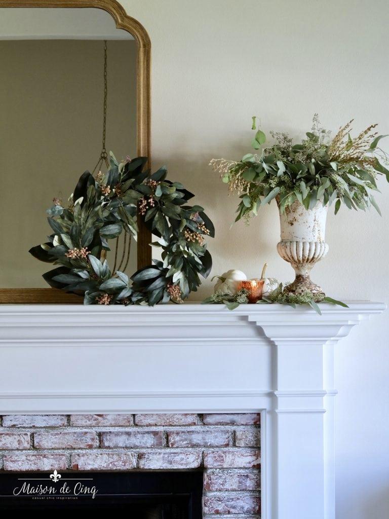gorgeous fall eucalyptus wreath and urn with greenery autumn mantel decor