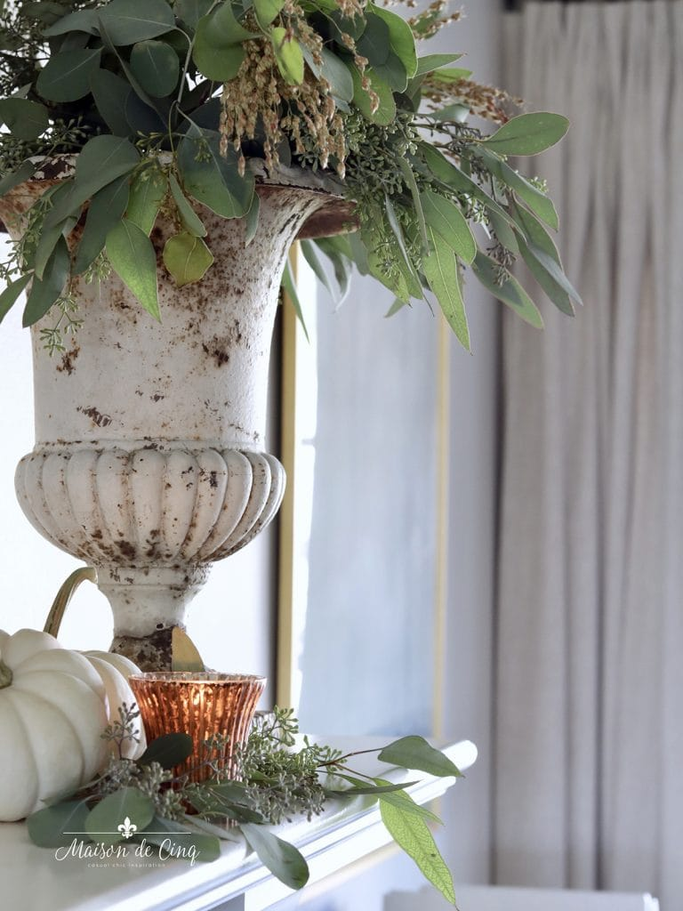 vintage French urn holds fall grasses and eucalyptus with copper votives simple fall decorating mantel decor