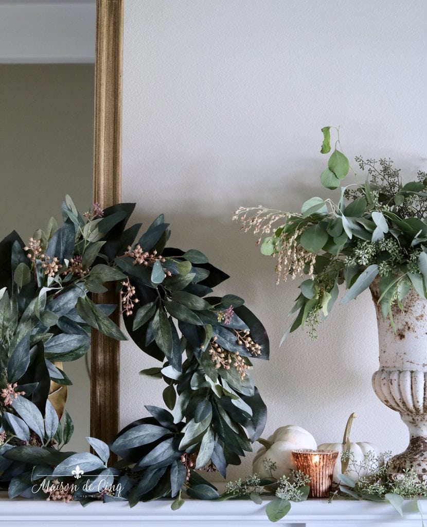 wreath and urn with eucalyptus fall decorating