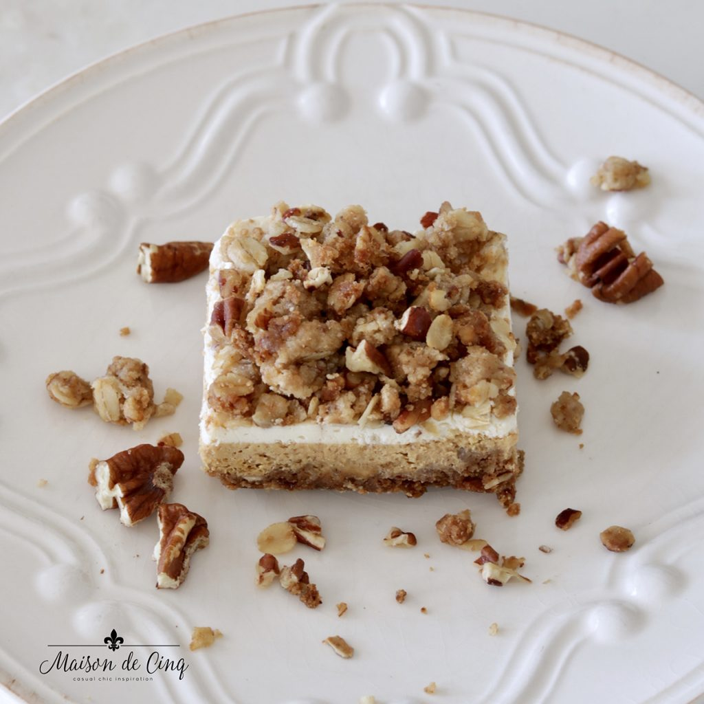 close up of pumpkin cheesecake bar with crumble topping delicious dessert fall recipe