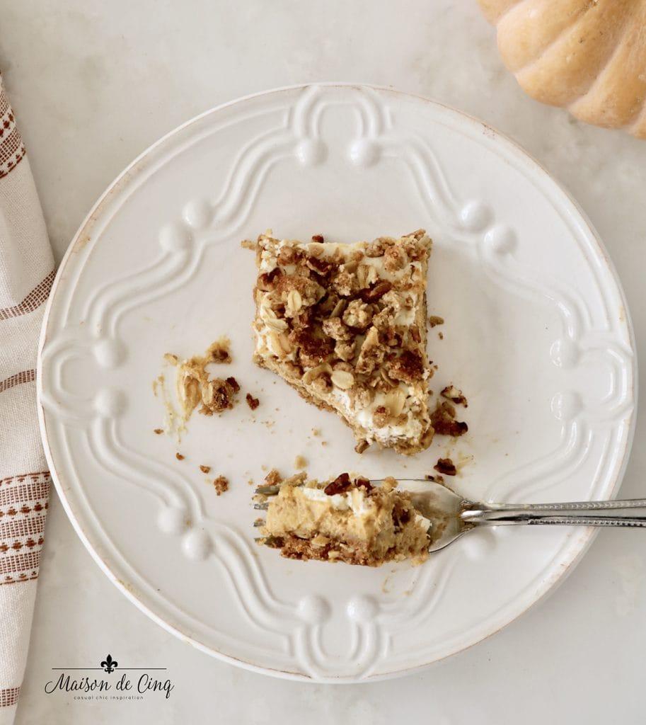 pumpkin cheesecake crumble bar on plate delicious fall dessert