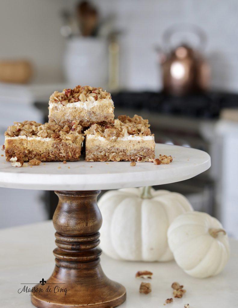 pumpkin cheesecake crumble bars on cake stand delicious fall dessert recipe snack