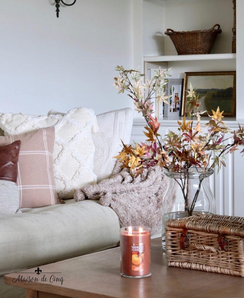 seasonal finds at Walmart fall pillows leaves and pumpkin candle fall decor