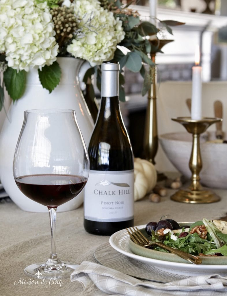 pinot noir red wine in glass with salad and flowers fall entertaining menu