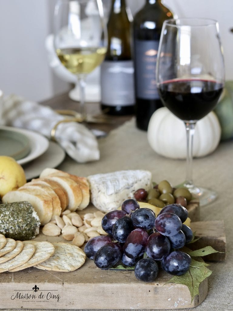 cheese board with grapes and olives red wine entertaining ideas