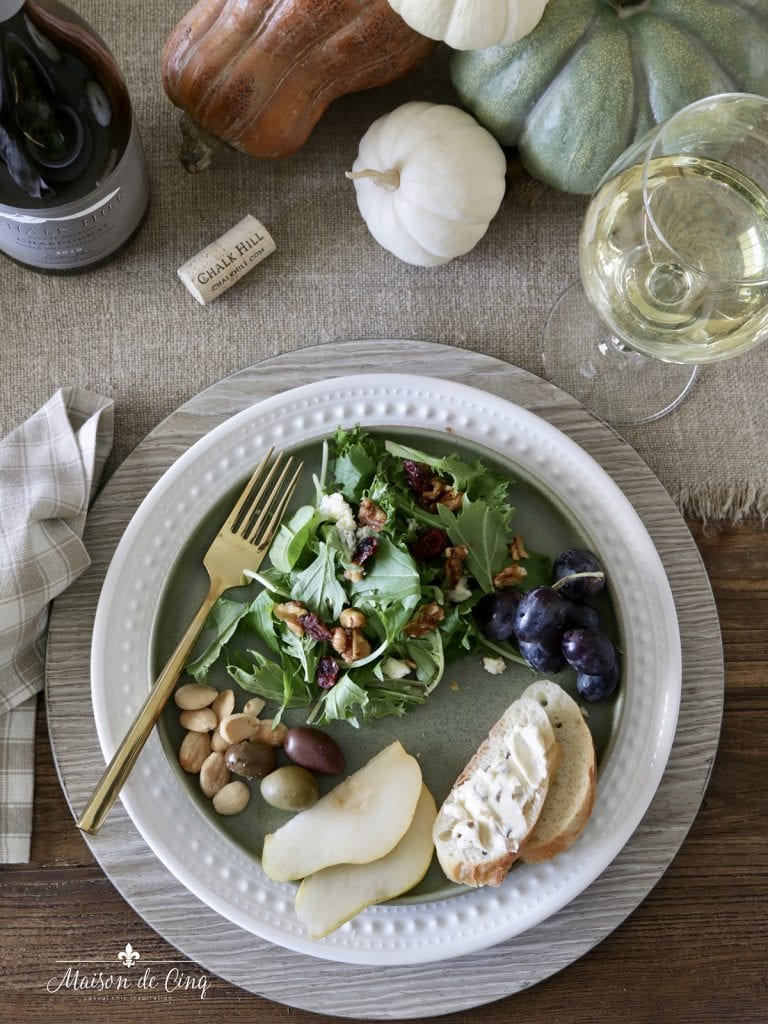 delicious fall harvest salad with charcuterie on plate white wine fall dinner party