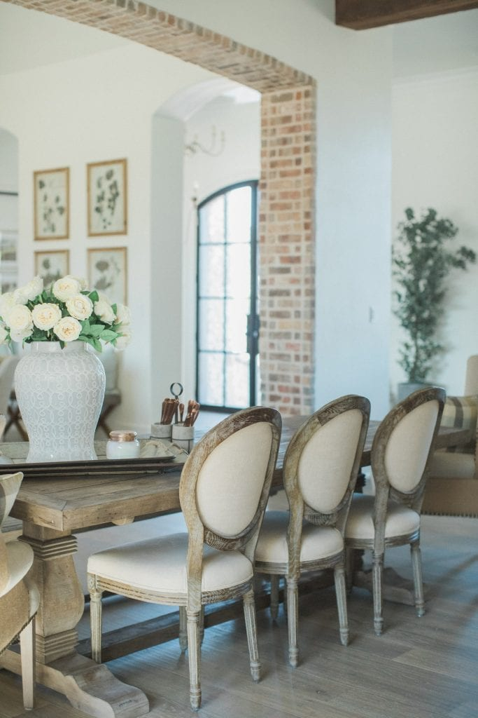 french farmhouse dining room brick archway