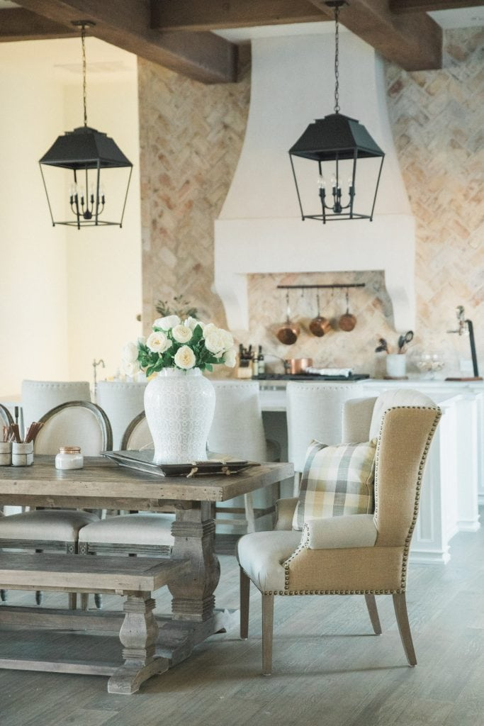french farmhouse style home kitchen with wood beams and rustic lanterns european farmhouse style