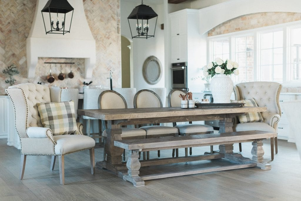 french farmhouse style kitchen with farmhouse table and beautiful rustic lanterns