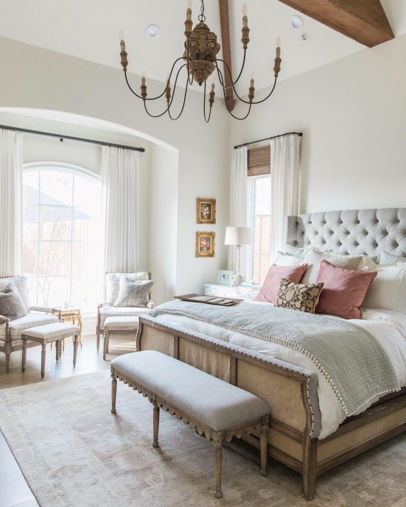 french farmhouse inspired bedroom tufted headboard french style bench and rustic chandelier